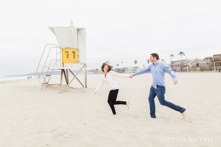 couple in love running on mission beach