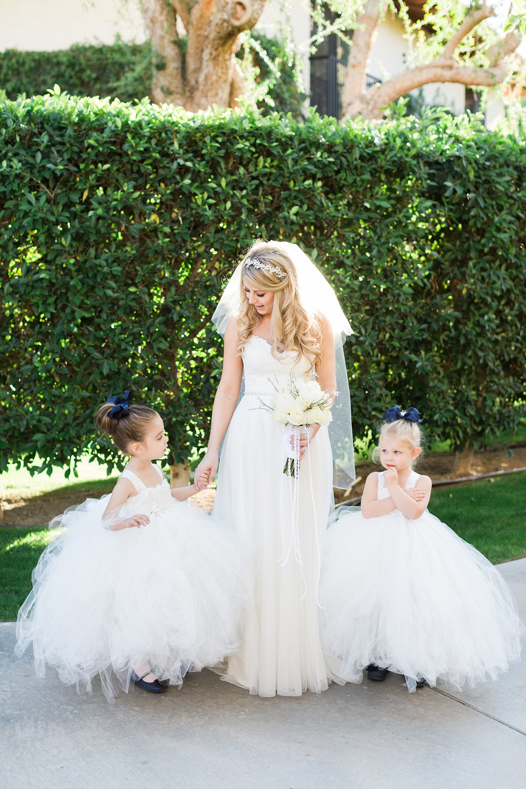 Bride and flower girls in puffy dresses