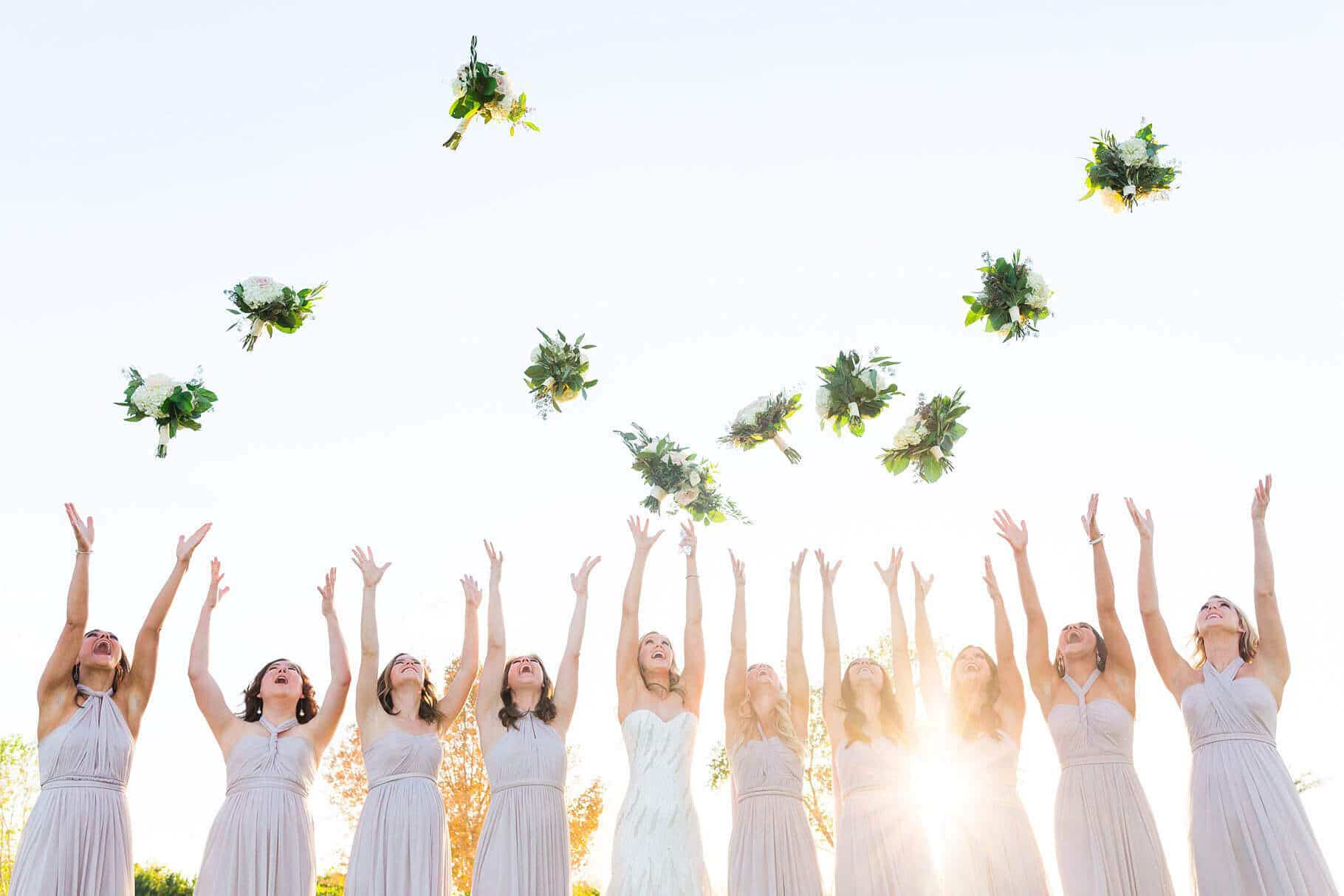 Encanterra Wedding- Bridesmaids Tossing Bouquets