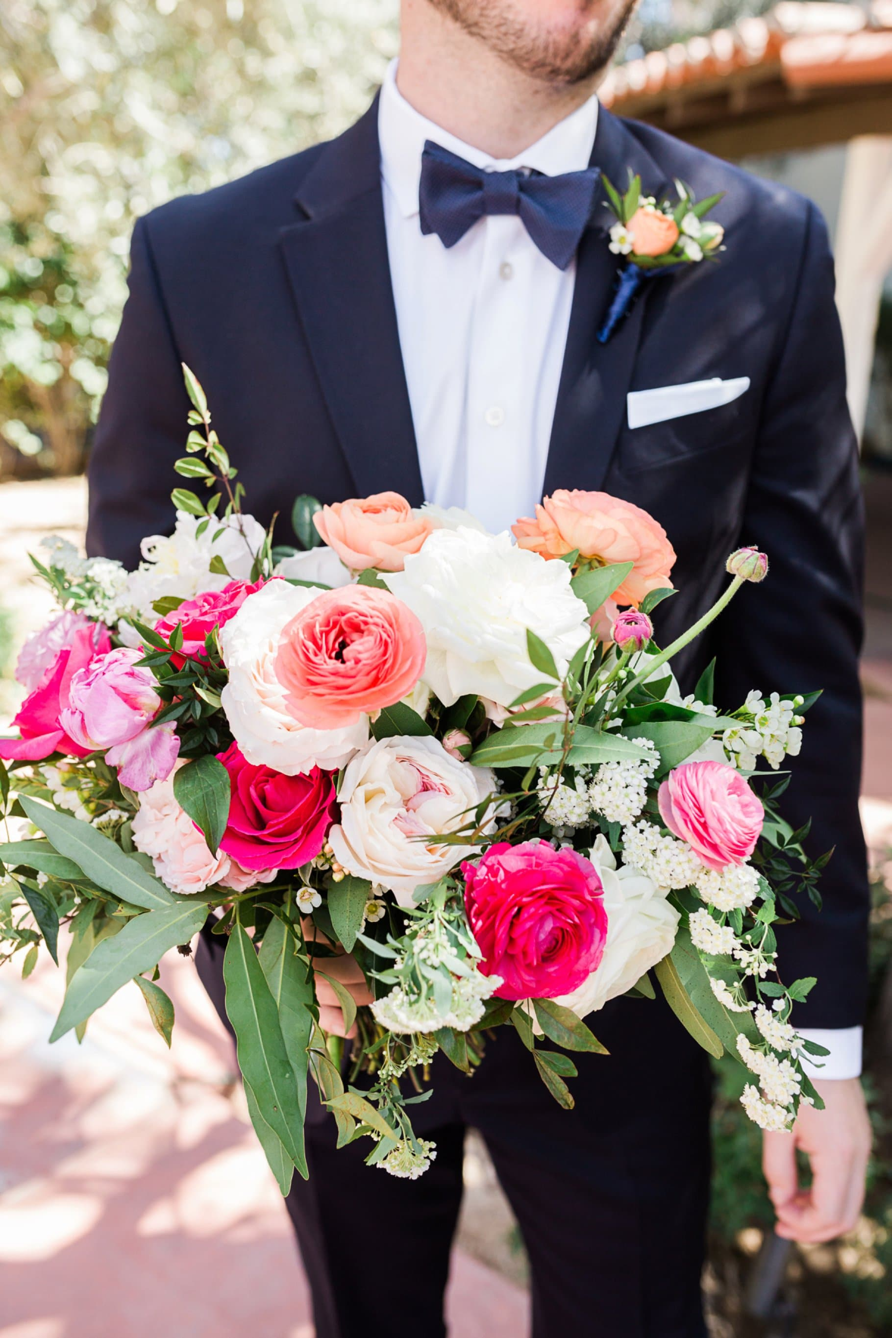 Groom Holding colorful wedding bouquet
