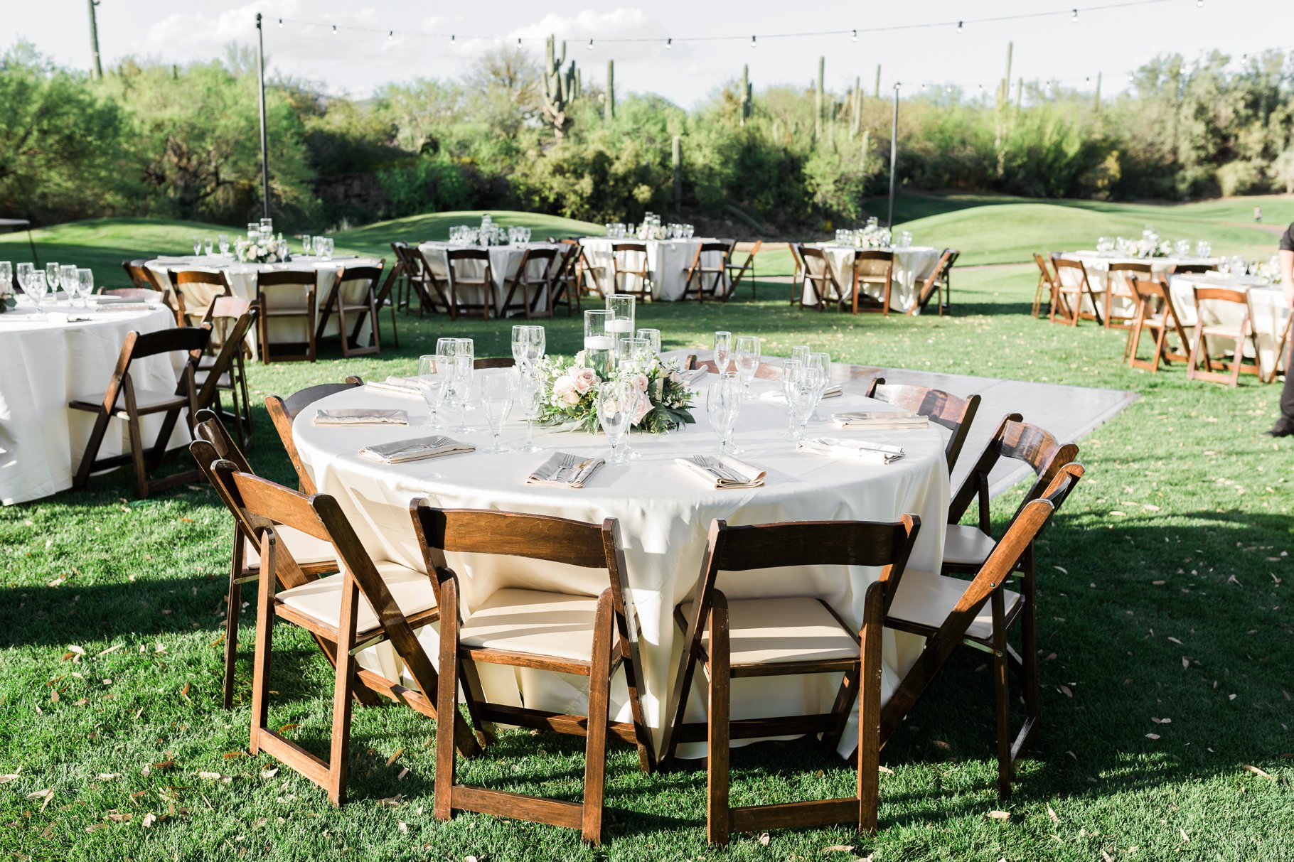 outdoor reception with wood folding chairs
