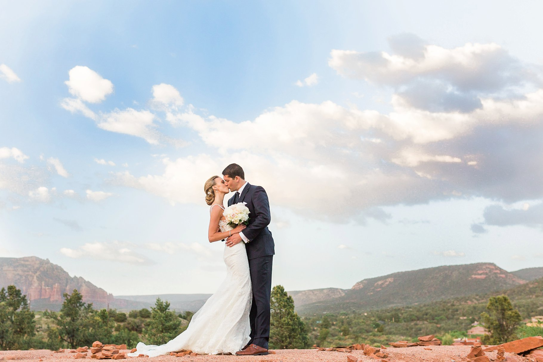 Bride and Groom kissing with Sedona backdrop