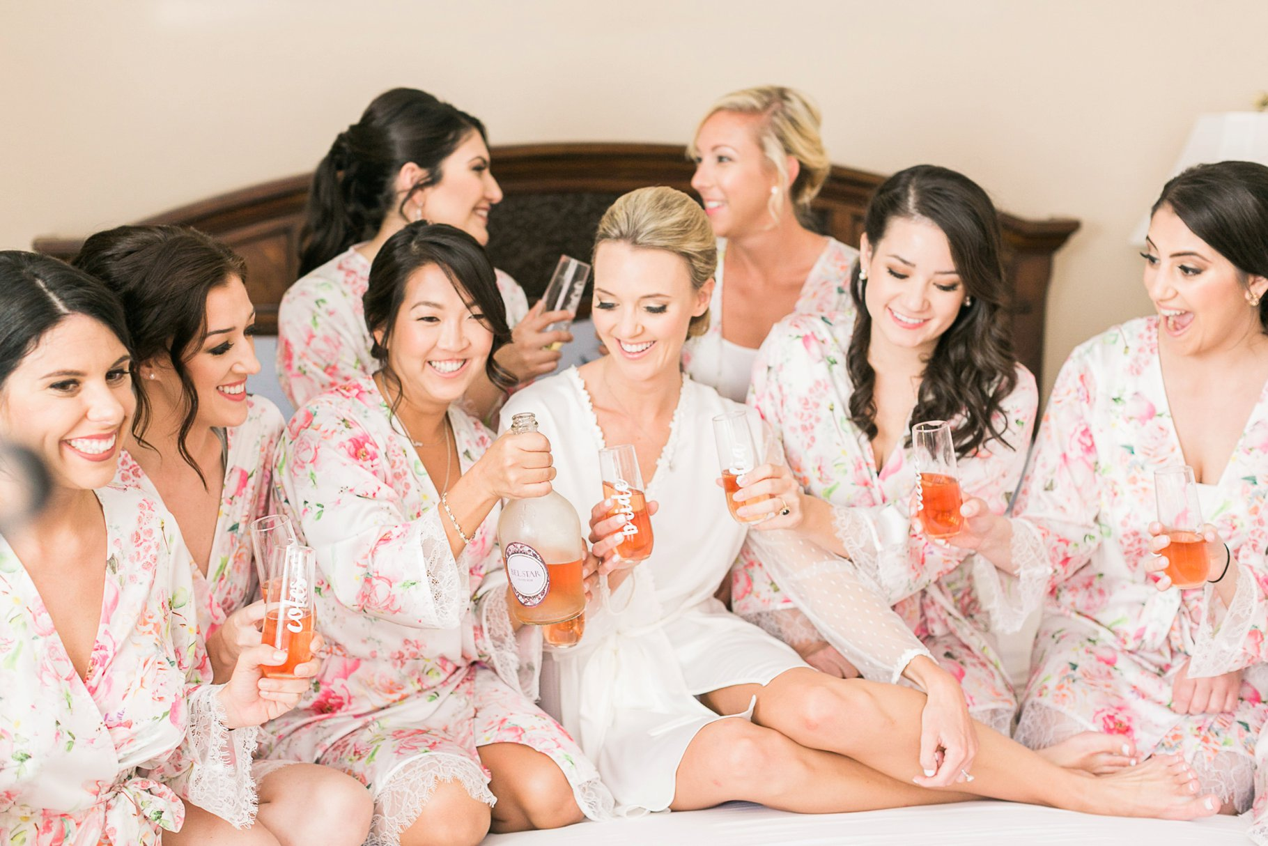 Bride and Bridemaids in Floral Robes toasting with champagne