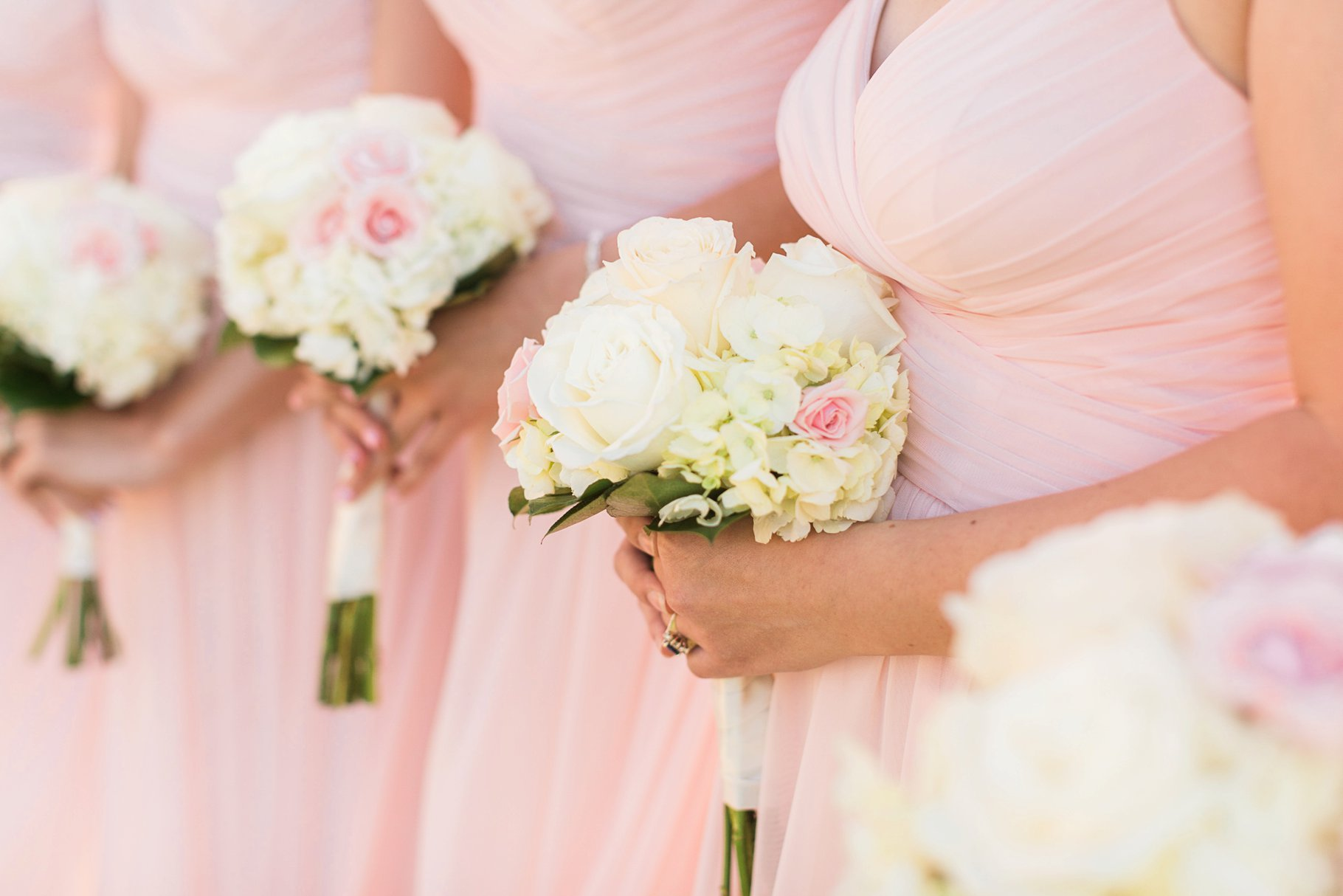 Pinkn bridemaids dresses with ivory rose and hydrangea bouquets
