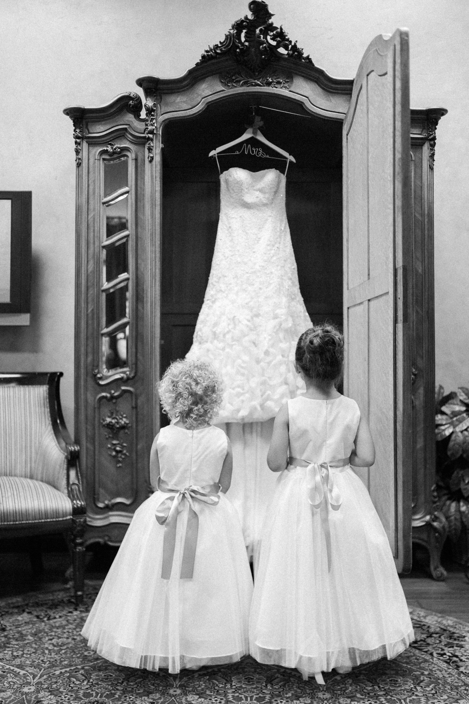 little  girls looking at wedding dress