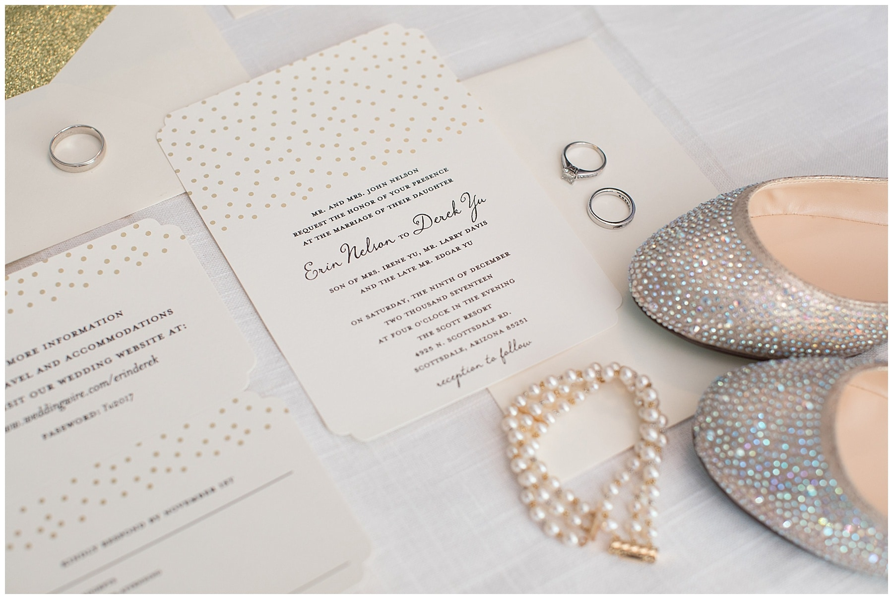 A detail photo showing shoes and jewelry alongside wedding invitation