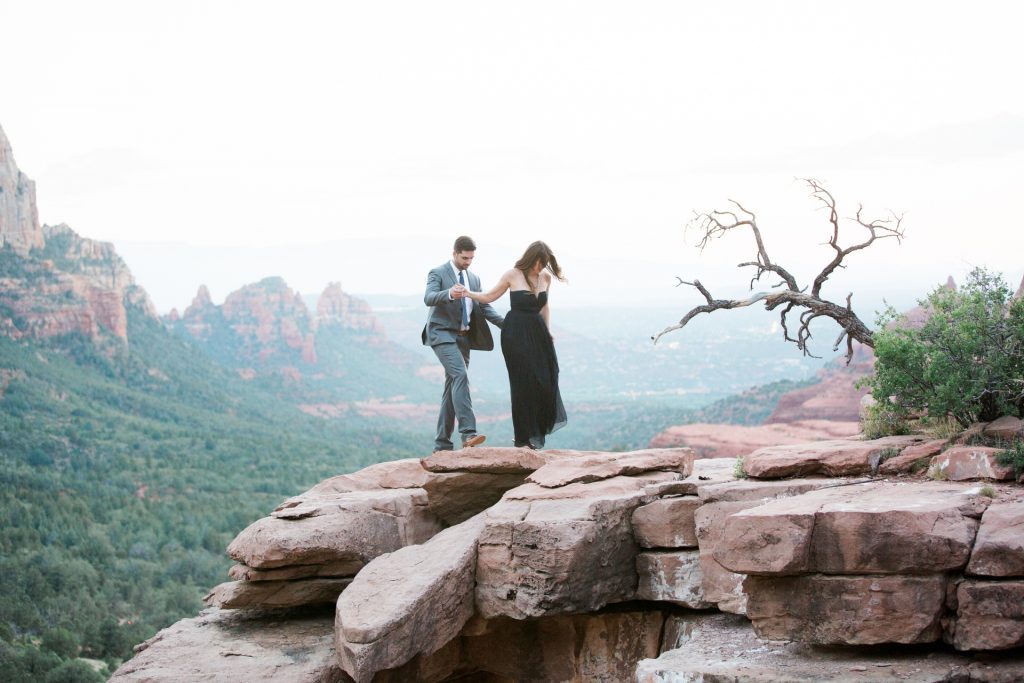 romantic couple at merry go round rock in sedona