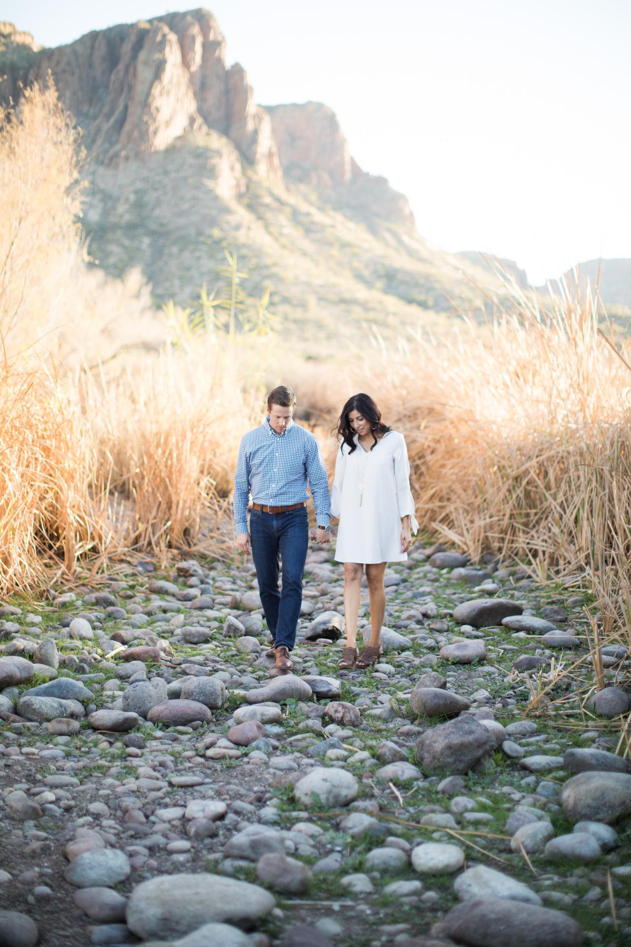 Couple holding hands walking at Saguaro Lake