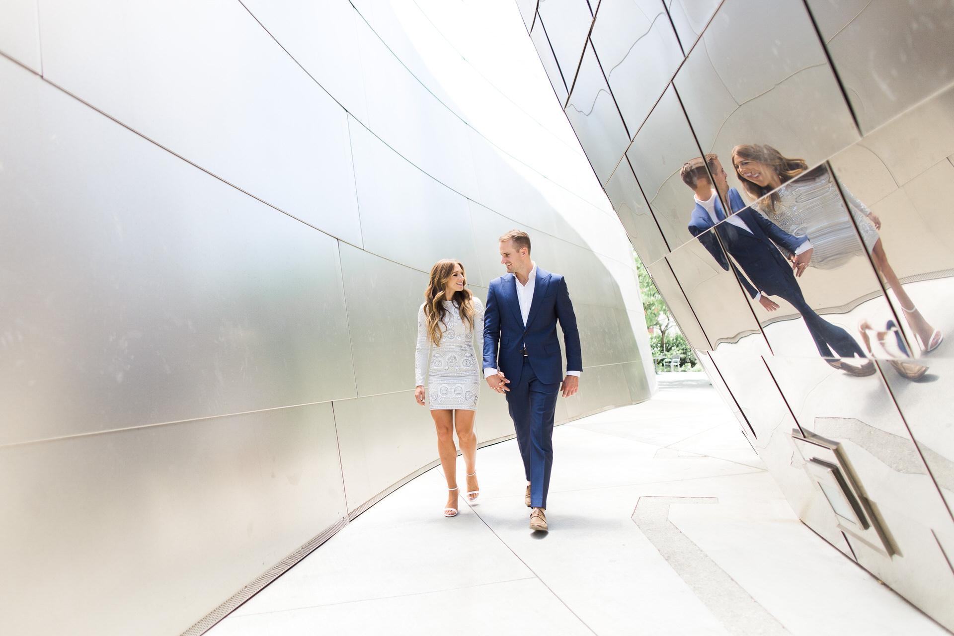 Couple walking at walt disney concert hall in los angeles