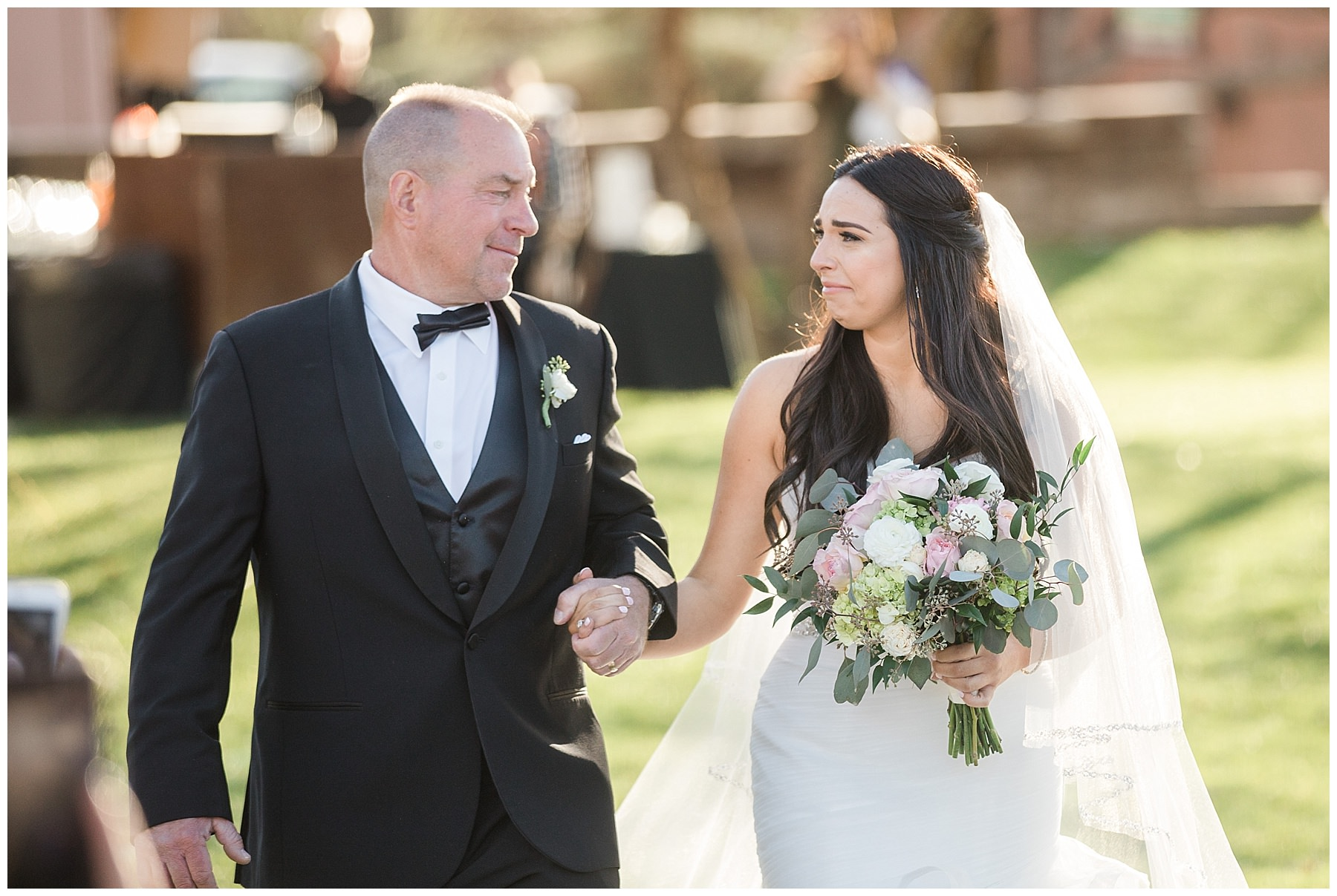 Emotional Bride and Father walking down aisle at wedding