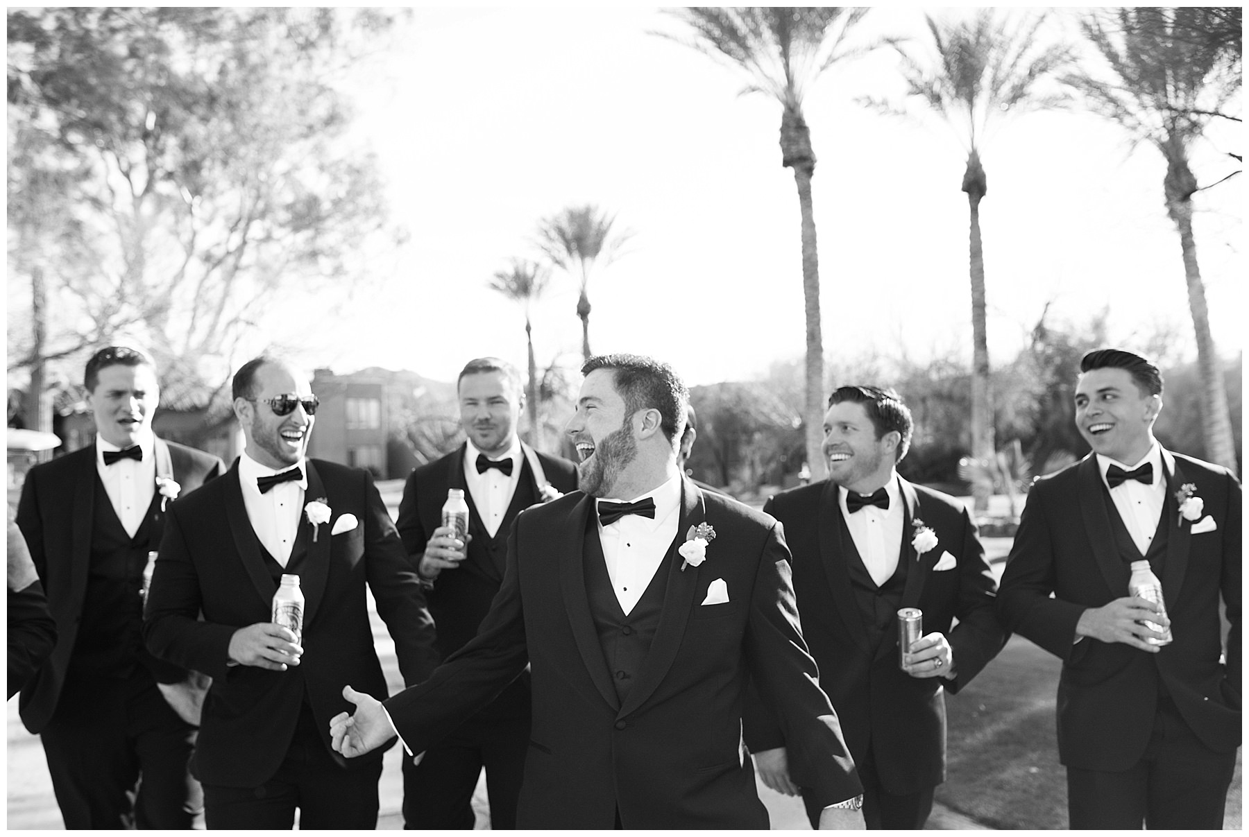 Black and White photo of groom and groomsmen laughing
